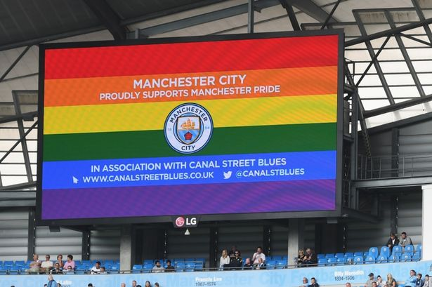 a-rainbow-coloured-screen-manchester-pride-at-the-etihad-in-august
